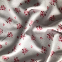 "Jersey velours ""pyjama"" fleurs roses fond rose 20 x 170 cm"