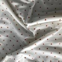Jersey pois rouille lurex fond blanc cassé 20 x 160 cm