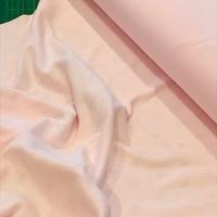 Jersey ajouré étoile fond rose pâle 20 x 140 cm