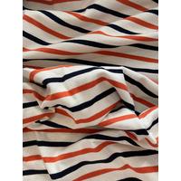 Maille polo orange et noir fond blanc cassé 20 x 140 cm