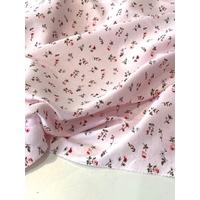 COUPON de jersey fleurs fond rose pâle 1m60 x 135 cm