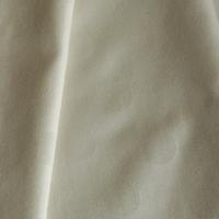 Tissu pois frappés fond beige