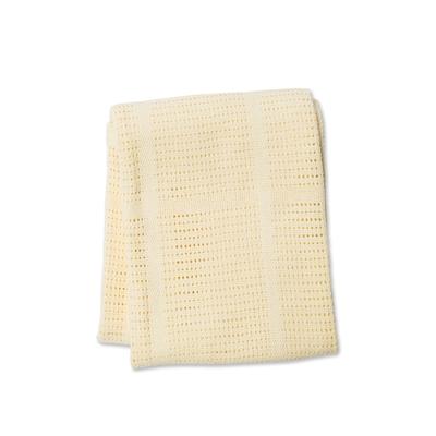 Couverture tricot jaune