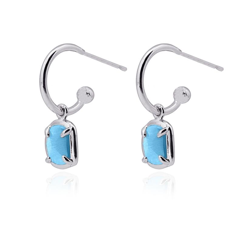 Boucles d\'oreilles avec pierre oeil de chat bleu