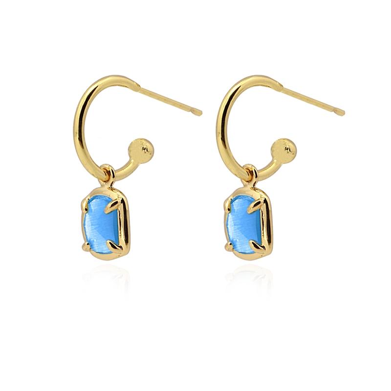Boucles d\'oreilles avec pierre œil de chat bleu