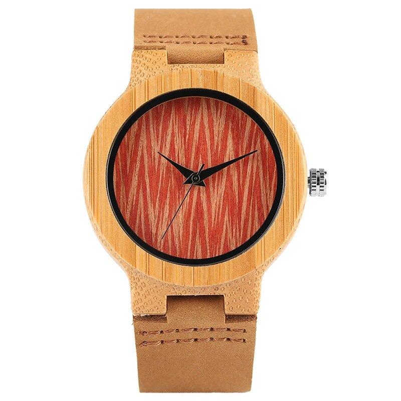 Montre vintage en bois avec cadran rouge aztèque