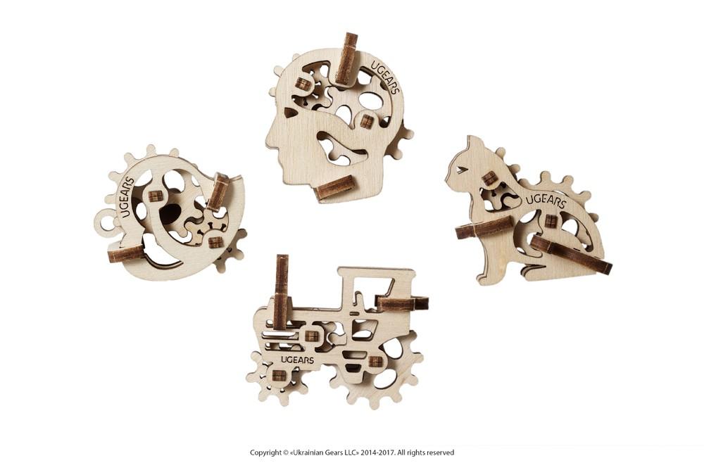Ugears - Ensemble en bois de 4 figurines mécaniques miniatures: tracteur, chat, tête et coeur