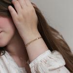 bracelet-femme-acier-or-porte-vctoire