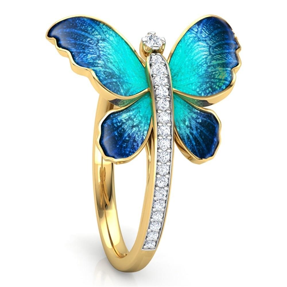 Bagues or papillon et strass