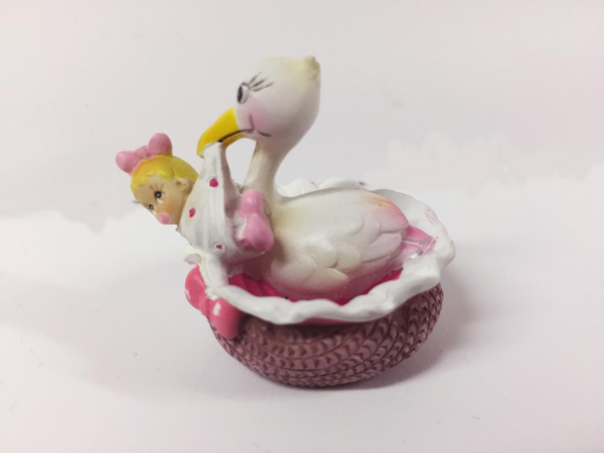 2 figurines en résine cigogne et bébé rose
