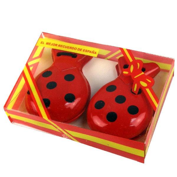 Castagnettes en bois rouges à pois noirs