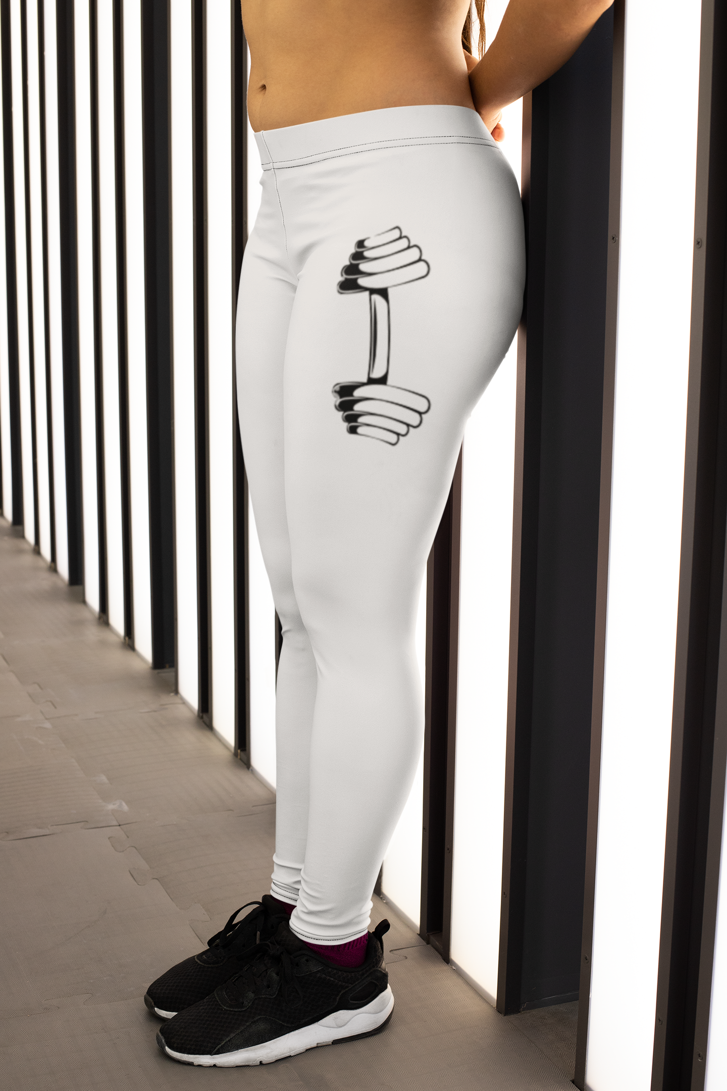 leggings-mockup-of-a-woman-leaning-against-a-wall-with-lights-28700