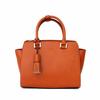 sac en cuir femme orange pompon