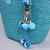 MQ-00116-turquoise-D3-sac-paille-plage-pompons