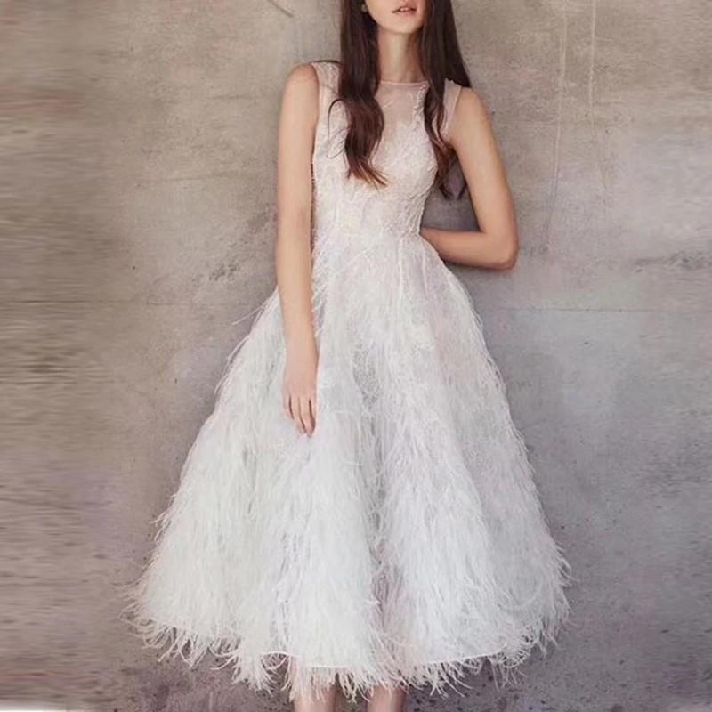 Robe de Soirée Danseuse mi Longue Perles et Plumes 2 Coloris