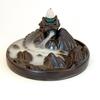 La majestueuse montagne en céramique avec dragon, brûleur d'encens à refoulement