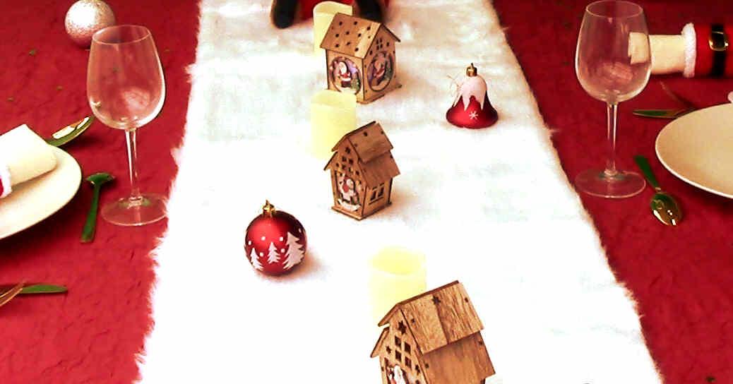 Idée de décoration de table de Noël avec des photophores maison Noël