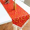 chemin-de-table-noel-rouge-et-or-motifs
