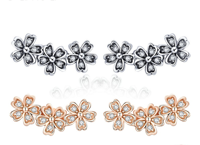 boucles d-oreilles fleurs manchettes
