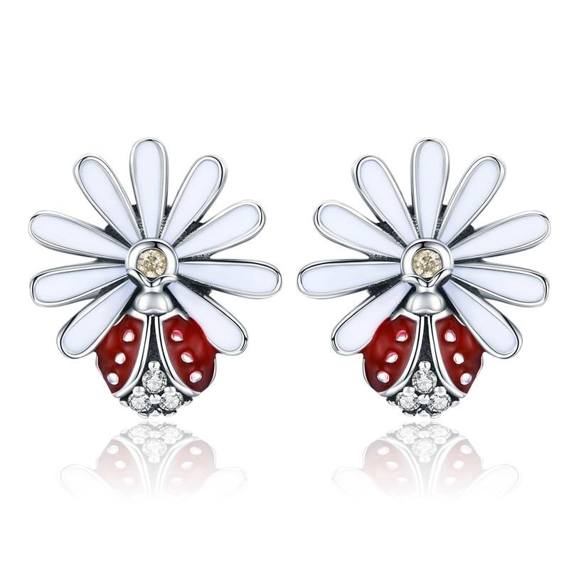 Boucles d\'oreilles coccinelle sur fleur argent